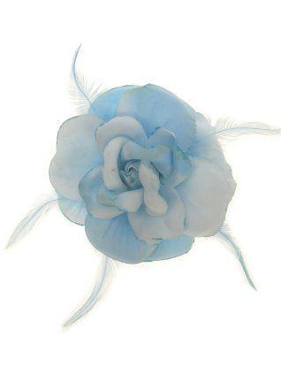 Bloem glitter met speld en elastiek blauw