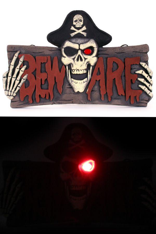 Bord BEWARE met piraat skelet met licht
